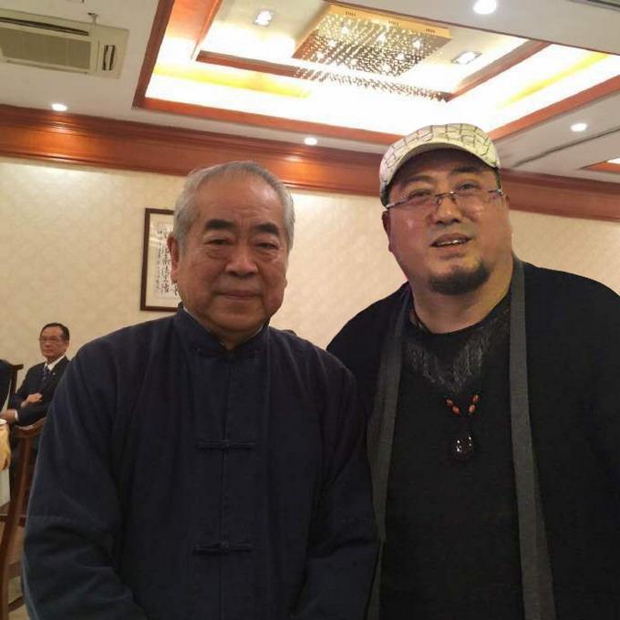 副会长吴熙明和范增老师在一起